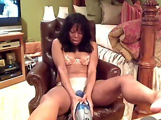 Black milf plays with a vacuum cle