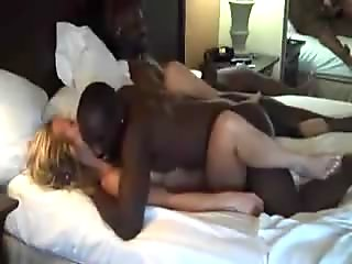 Two black guys share a white woman