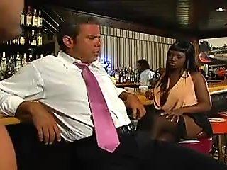 Ebony babe fucked in a bar.
