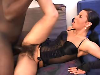 Sexy brunette in lingerie with a hairy bush gets pumped by black dick